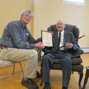 Wilmot Historical Society president Marc Davis presented Wilmot's Boston Post Cane to Roger Biron, Wilmot's oldest resident. Photo: Lindy Heim